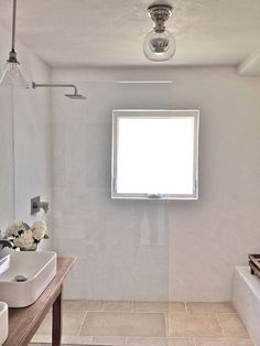 All of the walls in the room, including the shower, are covered in waterproof pool plaster.
