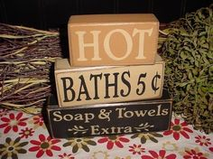 HOT BATHS 5 cents Soap and Towels Extra Wood Sign Shelf Blocks Primitive Country Rustic Home Decor Gift. $26.95, via Etsy.