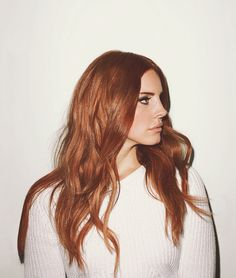 Lana Del Ray is looking stunning with her beautiful red hair color.