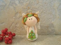 Angel and Christmas Tree  Figurine by countrycupboardclay on Etsy, $9.95