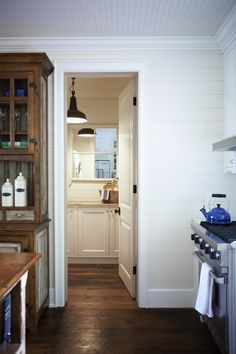 plank walls, love the floors!, white cabinets, planked ceilings...