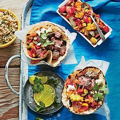 Steak Tacos with Charred Salsa | The Southwestern flavors bring Tex-Mex flare to the table. Try this fresh serving idea: Assemble and serve tortillas in parchment paper-lined cups. | SouthernLiving.com