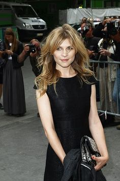 Clemence Poesy looks gorgeous with her bouncy waves.