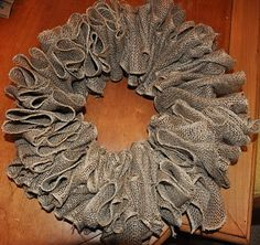I'm def gonna make this for the front door this weekend! So much cheaper than buying a wreath ring and I think it looks better than the pull-thru style. Maybe with some cute patterned burlap?!  Hobby Lobby here I come!