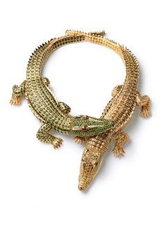 croc cartier necklace - commissioned by Maria Felix in 1975. Rumour has it Maria walked into Cartier in Paris with a jar containing a baby crocodile and handed it to designers. The piece above features two crocodiles which can be connected to create a necklace or separated and worn as two bracelets. The crocodile necklace uses 1,023 fancy yellow diamonds and 1,060 emeralds.