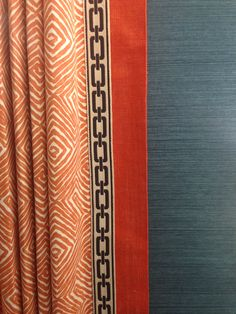 Drapery panel with banding and flat braid trim.