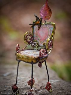 pretty little fairy chair. Champagne cork wires?