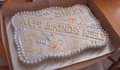 Cake designed after a rodeo belt buckle, for a girl