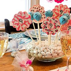 Girl or boy? Share the joy in a delicious way! Cute question mark cake pops and cookie pops for a gender reveal baby shower!