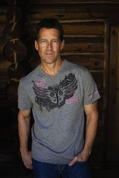 Inspired by James Denton, the classic Warrior heads take on a tattoo-like appearance on this special-edition unisex T-shirt created to support The Pink Fund.* Made from a tri-blend fabric (poly, ring-spun cotton and rayon). Machine wash cold. Tumble dr