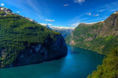 this Geirangerfjord was one of the most visited tourist sites in norway. It is visited by 150-200 cruise ships and more than 700,000 tourists each year. It's located in the municipality of Stranda a 15-km (9.3-mile) long branch of the Storfjord with depth reaching over 600 m (1.9 feet).