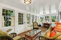 700 Hedges Sagaponack enclosed porch Love this enclosed porch with the white beamed ceiling and brick floor. So homey!!