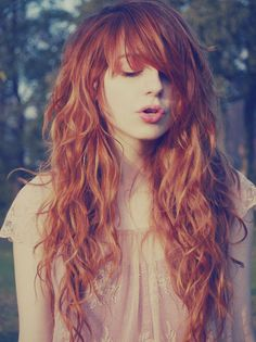 Curly Redhead w/ Long Bangs: We're told often that wavy to curly hair shouldn't have bangs. Really? Well, she begs to differ.