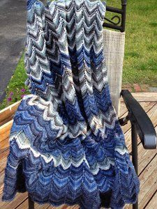 This beautiful, blue, chevron striped knit blanket pattern is one you'll love displaying in your home. The Colorado River Throw is a gorgeous mix of deep blues, grays, and white.