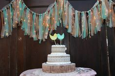 DIY Wedding Backdrop; Icicle lights with fabric, hanging on old doors