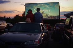 See a movie at a drive-in theatre...