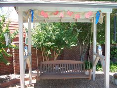 Outdoor swing to the right of gazebo.  Personalized birthday banner made to perfectly match.