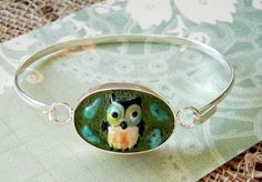 A sweet DIY bracelet with turquoise nuggets and a lampwork owl bead embedded inside a silver amate bezel  with green EnCapture Artisan Concrete (all parts available at www.rings-things.com)