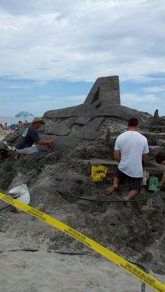 Matt Deibert sculpting the Ashore Realty logo assisted by Dennis Allen
