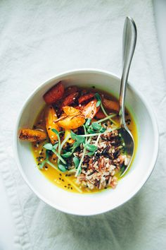 roasted carrots + rice with zingy turmeric broth // 2 med carrots, scrubbed + cut into 1 inch pieces oil fresh/dried thyme leaves  salt + pepper sizeable knob of coconut oil/ghee 1/2 shallot 1 clove of garlic, minced 1 thumb-sized piece of ginger, peeled + minced 1-2 tsp ground turmeric 1 c filtered water juice from 1/2 a lemon cooked brown/wild/whatever rice for serving  sprouts/shoots/small greens of some kind