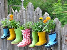 Great use for rain boots. Drill holes in the bottom for drainage, Fill the feet with pebbles and the legs with soil. Plant whatever.