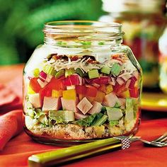 Layered cornbread and turkey salad in a jar.