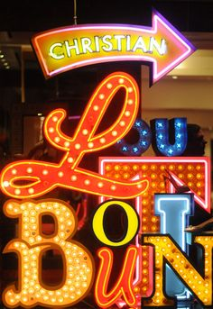 #ChristianLouboutin uses colorful #neon signs in store to signpost their brand and create impact, with this cool use of marquee circus letters.