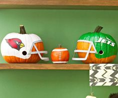 It's football season! Don't wait until October to dress up your front porch, do it today with these festive helmet and ball creations.
