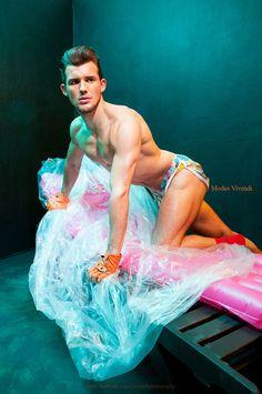 Heat of the night by photographer Gavin Harrison. Model Ryan Noble, shorts by Modus Vivendi