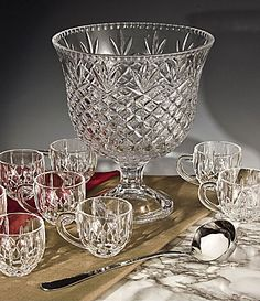 Crafted of 24% full lead crystal and accented with brilliant crisscross cuts and beaded edging, this set includes a footed punchbowl, 8 cups and a stainless steel ladle.
