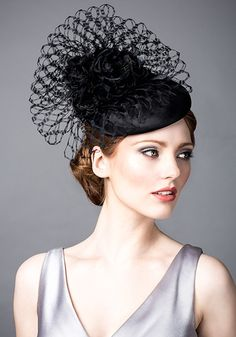 Rachel Trevor Morgan, A/W 2014. Black silk taffeta beret with flowers and veiling.