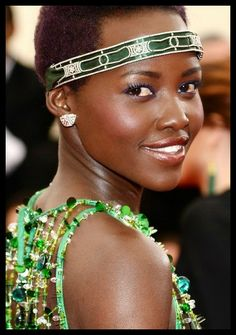 Actress Lupita Nyong'o with Met Gala outfit and bandeau. The diamond bandeau is Art Deco Cartier. I assume they switched out the ribbon to match her dress.