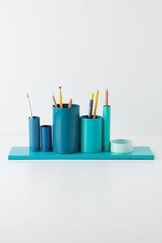 Pretty desk organizer :), get a flat piece of wood, pvc pipe and some glue to connect it to the board with some spray paint and your done.
