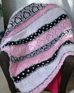 Pink & black rag quilt in strips instead of squares.