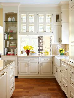 pretty glass front and back cabinets allow light into kitchen