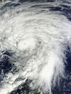 """ NASA's Terra satellite flew over Hurricane Sandy around noon local time on Oct. 25, it captured a visible image of Hurricane Sandy that showed the large extent of the storm. Sandy has grown since the morning hours on Oct. 25 by about 120 miles in diameter according to satellite data."""