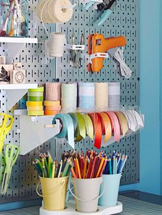 Hardworking Walls     Inside the closet, a metal pegboard provides sleek, efficient access to crafts tools and supplies. A wall-mount ribbon holder makes gift wrapping a snap. Small buckets of colored pencils stay organized and accessible on a desktop turntable