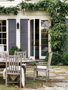 gray shutters + modern french doors + climbing greenery