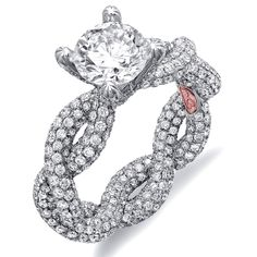 Pretty Nice !!        Available in White or Yellow Gold 18KT and Platinum. 3.33 RD    Capture her grace and endless beauty with this confident yet elegant design.  We have also incorporated a unique pink diamond with every single one of  our rings, symbolizing that hidden, unspoken emotion and feeling one  carries in their heart about their significant other.    This is not just another ring, this is a heirloom piece of jewelry.