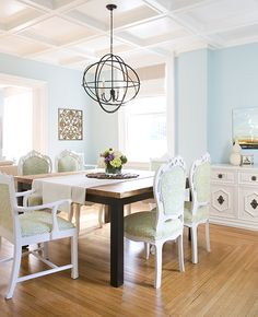 there is a lot to love- coffered ceiling, orb lighting, bright and airy feel...paint color.