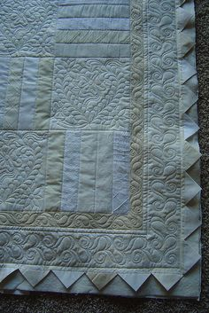 white on white    Pieced by Toni Kazarian. Quilted by Jessica's quilting studio. The prairie point border adds a lovely touch