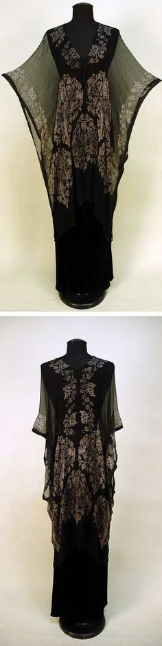 Stencilled black silk gauze tunic, probably Gallenga, 1920s. Square-cut wrap with silver Renaissance-style trees and stylized creatures. Black Venetian glass beads along hem and knotted cord closure with glass bead tassels.  Via Whitaker Auctions.