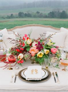 Outdoor tablescape with a bright centerpiece - Big Blooms - Jen Fariello Photography