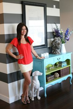 Stripe walls + turquoise and green console in home of Jillian Harris