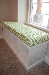 Turn a bookshelf on it's side and add an upholstered foam top to make a cute storage bench @ Home Improvement Ideas