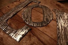 Distressed metal - actually cardboard, aluminum foil and paint!