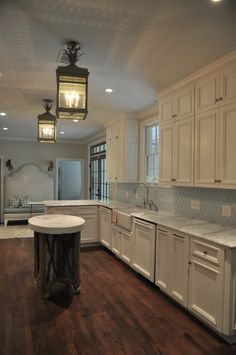 Love the cabinet color, the wood floors, and definitely the backsplash. Total kitchen inspiration!! (except for the lights and island; not really a fan of those)