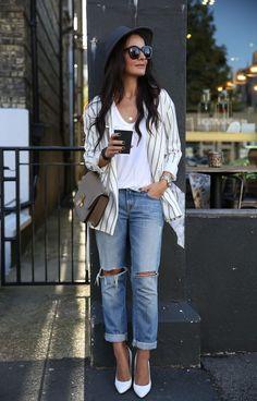 Ripped jeans, white pumps, striped blazer.