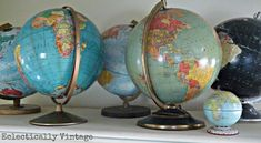 Displaying Vintage Collections - from Globes to Demijohns to Billiard Balls