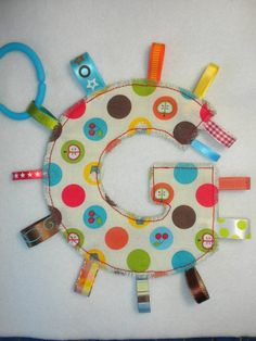 cute idea  http://www.etsy.com/listing/70527551/yummy-treats-monogram-tag-toy